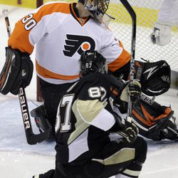 Pittsburgh Penguins' Sidney Crosby (87) fires a first-period goal past Philadelphia Flyers goalie IIya Bryzgalov (30) during Game 2 of an opening-round NHL hockey playoff series in Pittsburgh, Friday, April 13, 2012.