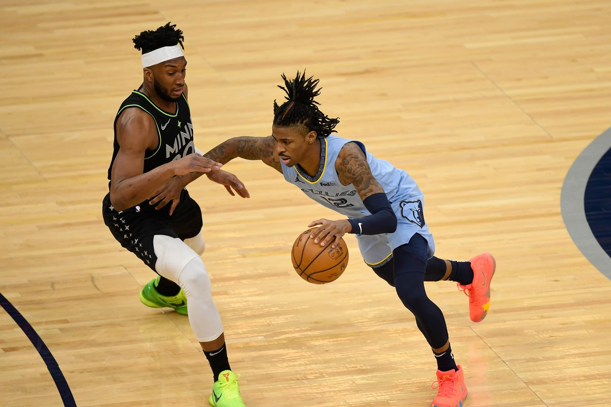 Josh Okogie of the Minnesota Timberwolves defends against Ja Morant of the Memphis Grizzlies during the first quarter of the game at Target Center on May 5, 2021 in Minneapolis, Minnesota.