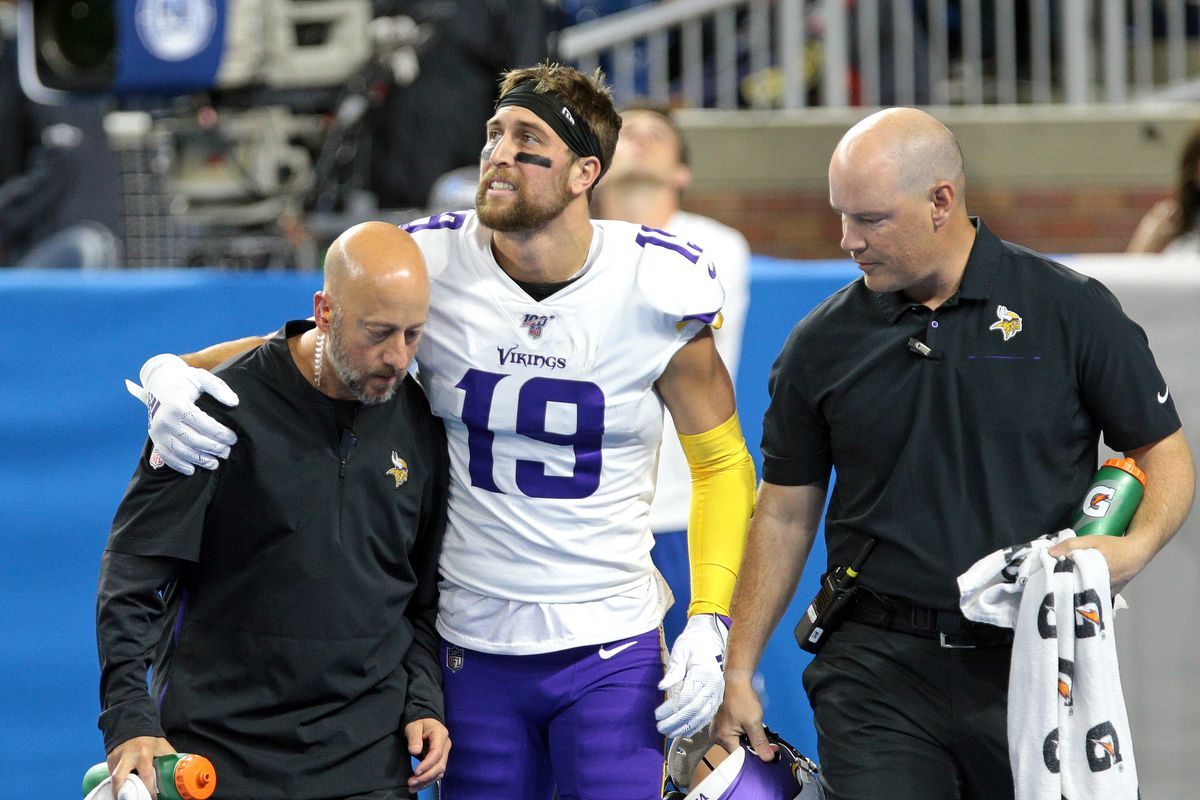 Minnesota Vikings wide receiver Adam Thielen grimaces in pain after making a touchdown during the first half of an NFL football game against the Detroit Lions in Detroit, Michigan USA, on Sunday, October 20, 2019.