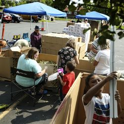 Boxes of food are sorted at the Utah Food Bank mobile pantry at The Church of Jesus Christ of Latter-day Saints' Cannon Stake Center in Salt Lake City on Wednesday, Sept. 1, 2021.