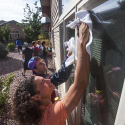 Union football players Villiami Lutui and Brock Timothy join their teammates in cleaning the windows of the Basin Rehabilitation and Senior Villa in Roosevelt on Tuesday, Sept. 24, 2013. The football coaches at Union High School have taken a stand against poor performance in the classroom and bullying outside the classroom, including disrespect of teachers and students.