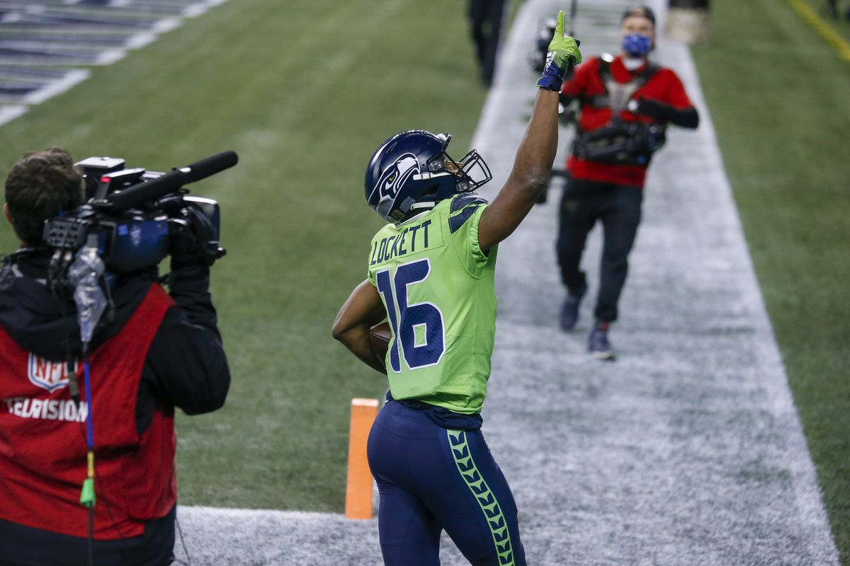 Seattle Seahawks wide receiver Tyler Lockett (16) celebrates after catching a touchdown pass against the Arizona Cardinals during the second quarter at Lumen Field.