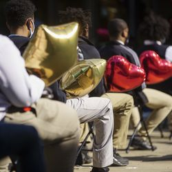 Classmates hold balloons for Rashad Verner during a memorial for Verner at Urban Prep Academy High School Bronzeville Campus at 521 E 35th St in Ida B. Wells / Darrow Homes Tuesday, Oct. 6, 2020.