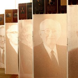 Elder Paul Hatt of the Utah Provo Mission looks at a display at the St. George Temple visitors center chronicling the life of President Hinckley.