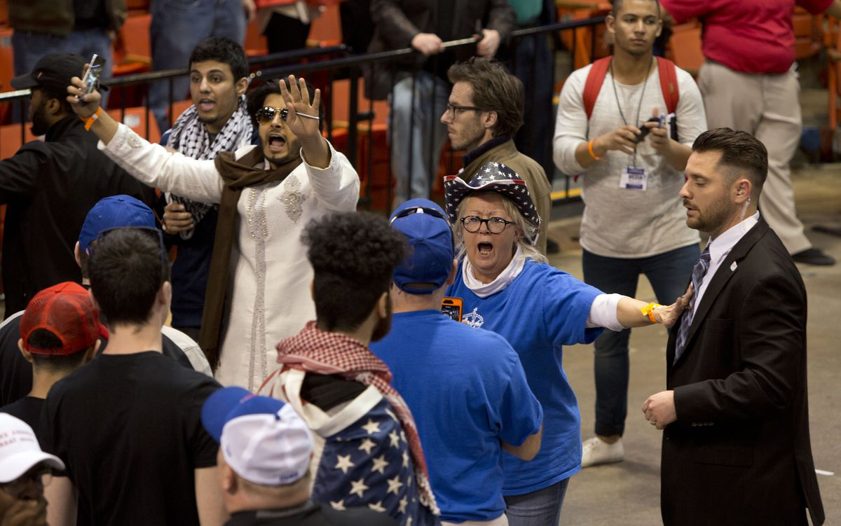 A Trump supporter yells and shoves during the cancelled Donald Trump rally in Chicago.