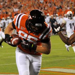 Virginia Tech's Eric Martin (86) hauls in a touchdown catch against Georgia Tech during the first half of an NCAA college football game, Monday, Sept. 3, 2012, in Blacksburg, Va.
