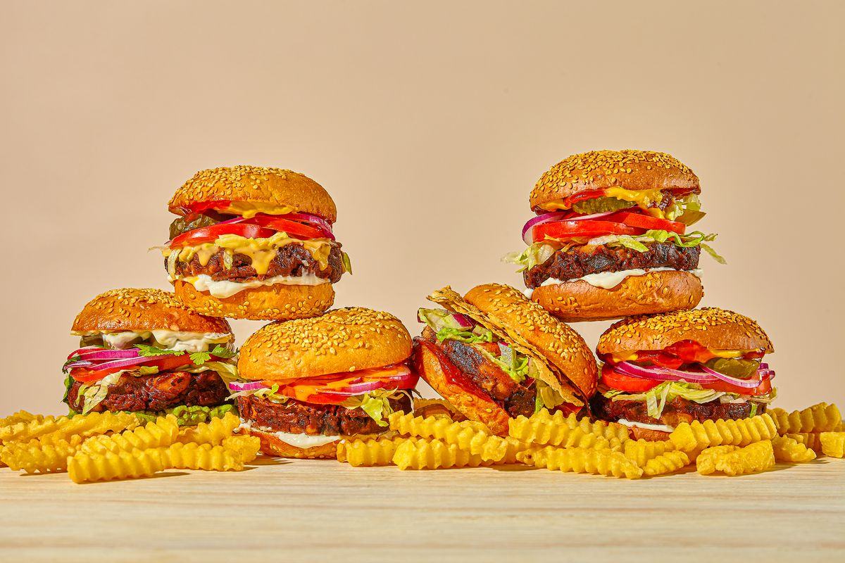 A bunch of burger places next to each other sitting on top of fries