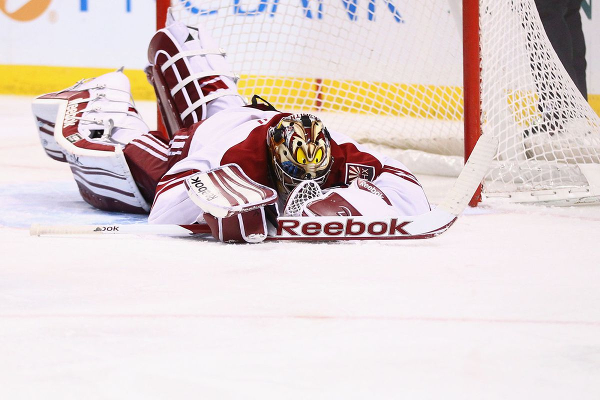 Mike Smith #41 of the Phoenix Coyotes reacts to allowing a goal against the St. Louis Blues at the Scottrade Center  on January 3, 2012 in St. Louis, Missouri.  (Photo by Dilip Vishwanat/Getty Images)
