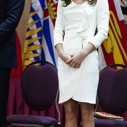 For day two of her Canadian tour with Prince William on July 1st, 2011, the Duchess wears a cream dress from Reiss and a hat by Sylvia Fletcher at Lock and Co.