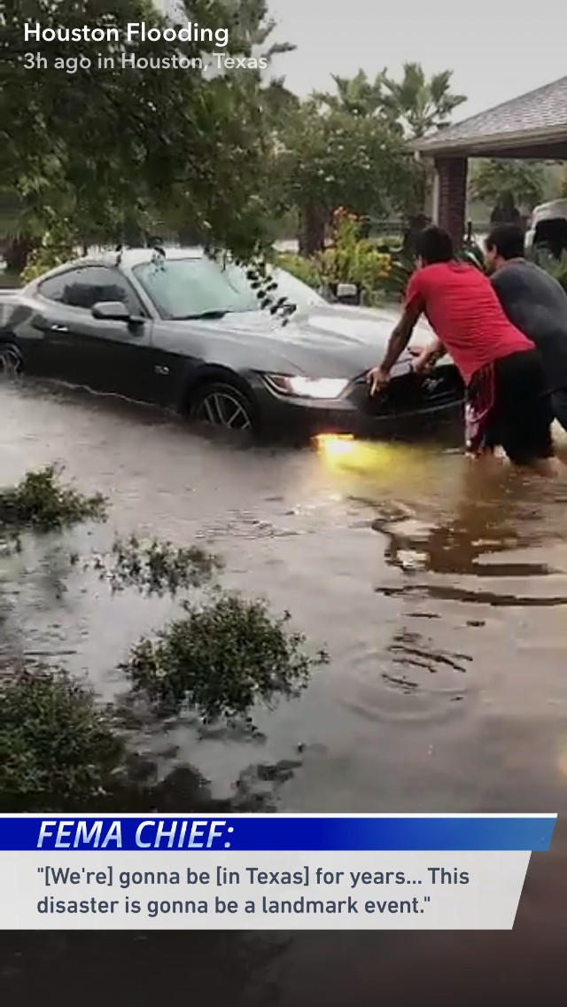 Screenshot of a Snapchat video showing a trapped car during Tropical Storm Harvey