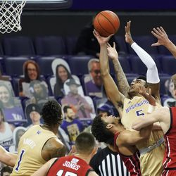 Washington forward Nate Roberts (5) puts up a shot between Utah center Branden Carlson (35) and forward Timmy Allen, third from right, during the second half of an NCAA college basketball game, Sunday, Jan. 24, 2021, in Seattle. Washington won 83-79.