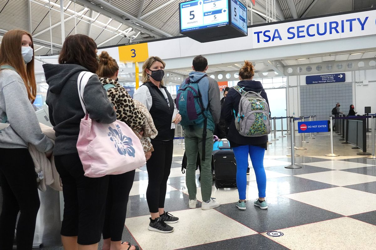 Travelers arrive for flights at O'Hare international Airport on March 16, 2021 in Chicago.
