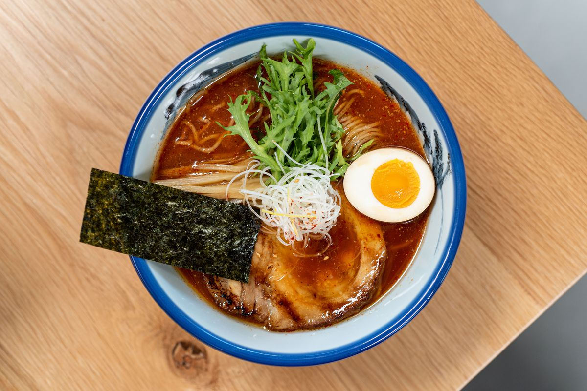 Yuzu ratan ramen from Afuri in Los Angeles in a blue and white bowl over birch table.