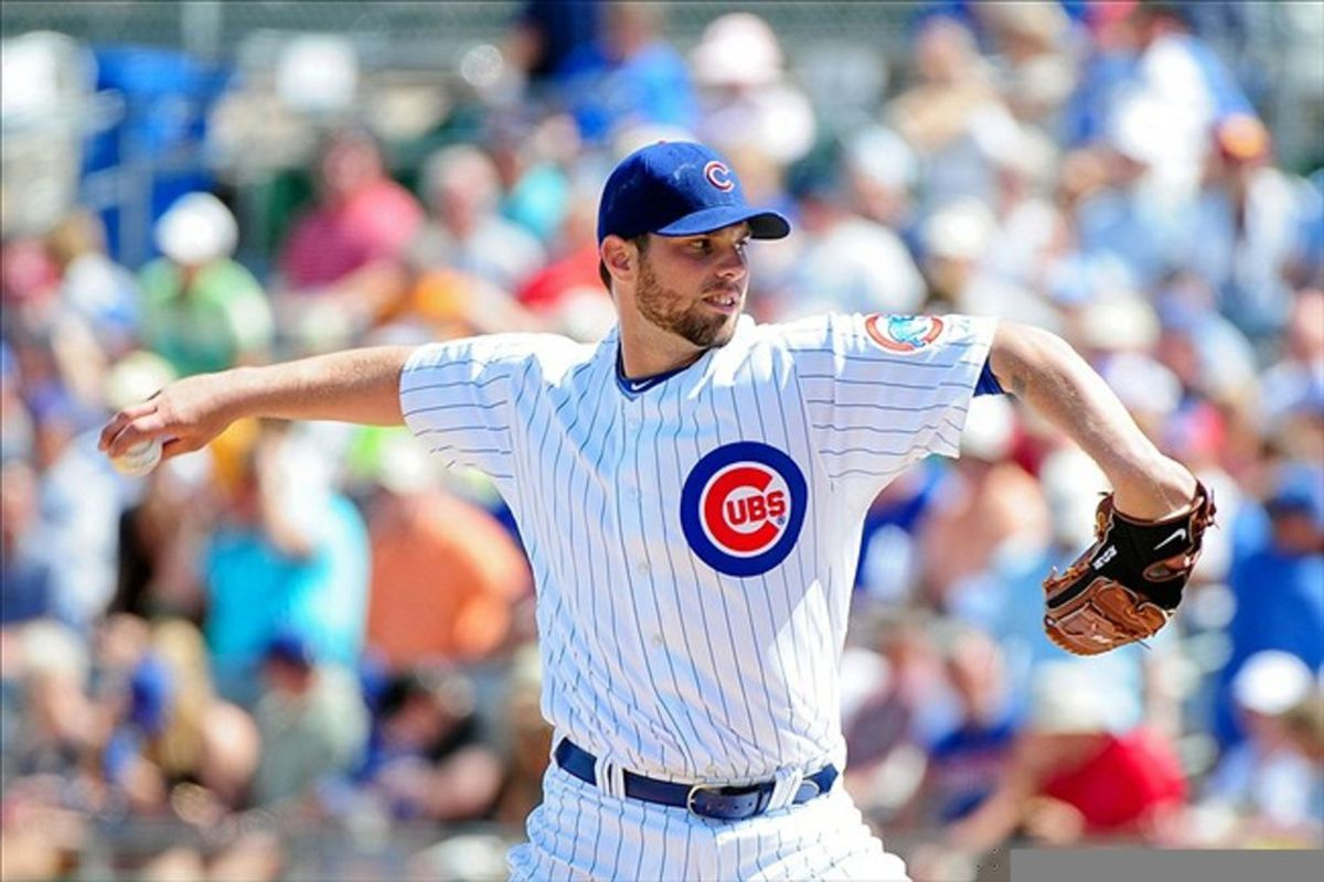 Mesa, AZ, USA; Chicago Cubs starting pitcher Randy Wells throws during the first inning against the Milwaukee Brewers at HoHoKam Park. Credit: Matt Kartozian-US PRESSWIRE