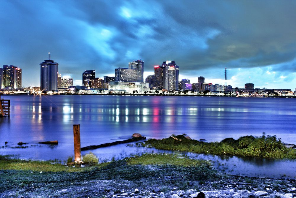 New Orleans city skyline reflected in water from Algiers point