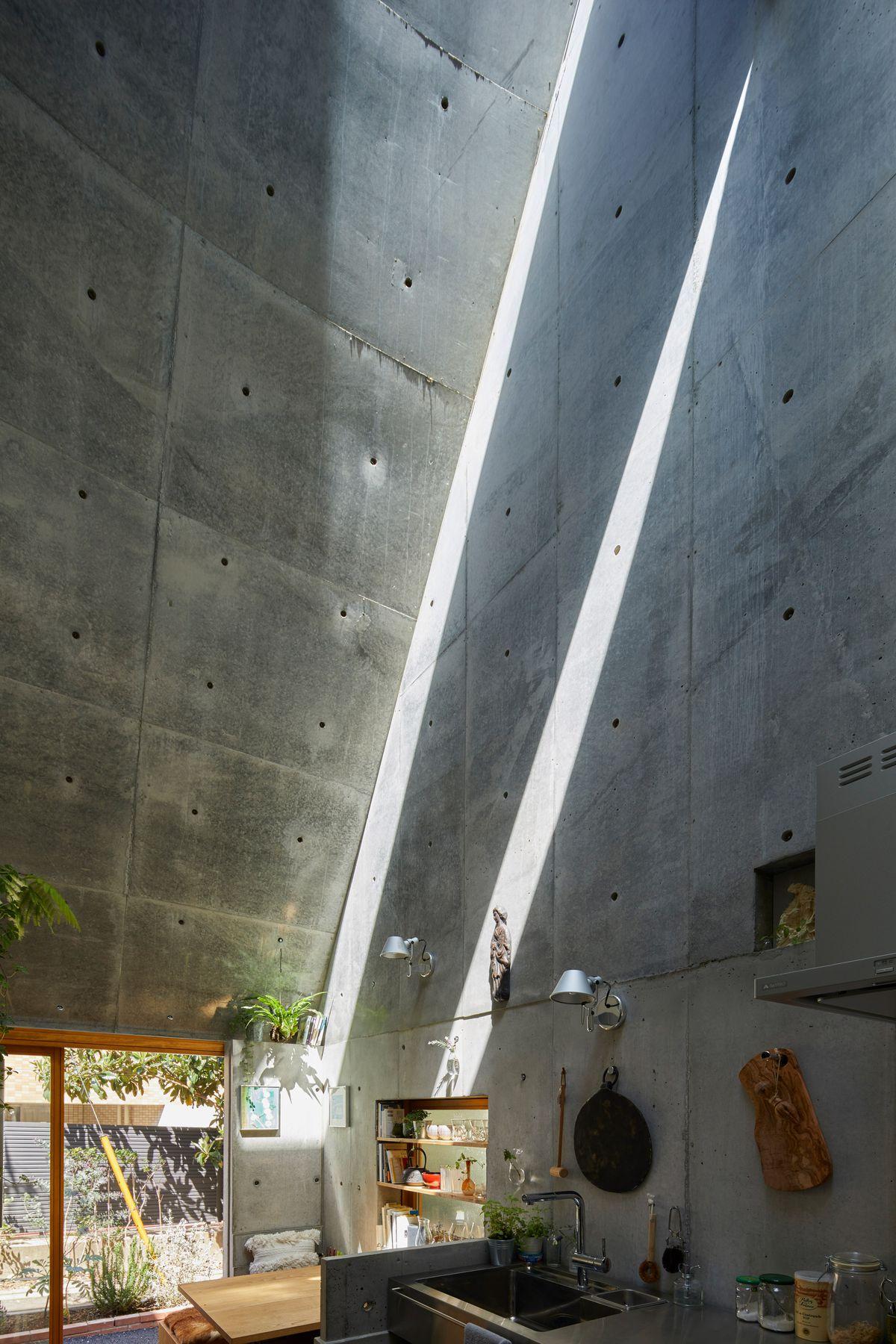 Light casting down concrete walls
