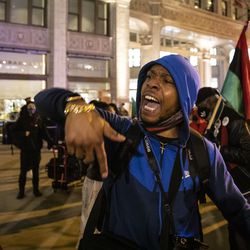 Lamon Reccord leads a chant as dozens of protesters to march down the Magnificent Mile after the city of Chicago released the videos of 13-year-old Adam Toledo being fatally shot by a Chicago police officer, Thursday evening, April 15, 2021. Toledo was shot to death by an officer on March 29 in an alley west of the 2300 block of South Sawyer Avenue in Little Village on the Southwest Side.
