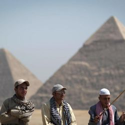 In this Thursday, Sept. 27, 2012 photo, tour guides wait for clients next to the Giza pyramids, near Cairo, Egypt. The Egyptian demonstrations against an online film that was produced by a U.S. citizen originally from Egypt and denigrates the Prophet Muhammad were part of a wider explosion of anger in Muslim countries. They happened near the U.S. Embassy, far from the pyramids of Giza on Cairo's outskirts, and a lot further from gated Red Sea resorts, cocoons for the beach-bound vacationer. Yet the online or TV images _ flames, barricades, whooping demonstrators _ are a killjoy for anyone planning a getaway, even though the protests have largely subsided. Tour guides in Egypt say tourist bookings are mostly holding, but they worry about a dropoff early next year, since people tend to plan several months ahead.