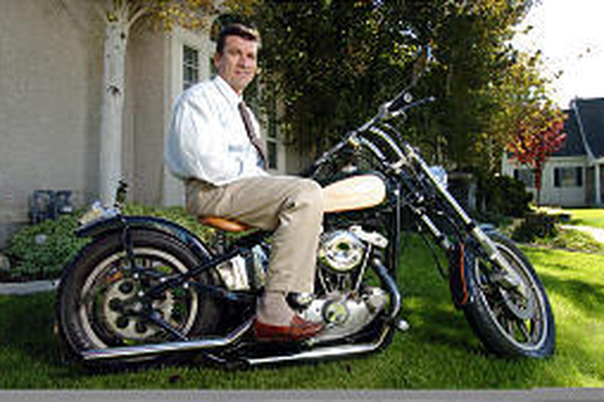 Democratic attorney general candidate Greg Skordas sits on one of his two Harley-Davidson motorcycles.