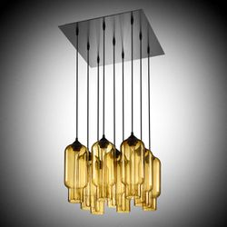 This undated publicity photo provided by Niche Modern shows a 9 Pack Modern Chandelier with Pharos pendants hand-blown in translucent amber, created by the Beacon, New York company.