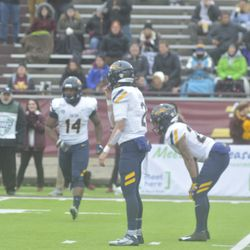 Reggie Gilliam goes into motion while Cater Bradley and Bryant Roback await the snap.