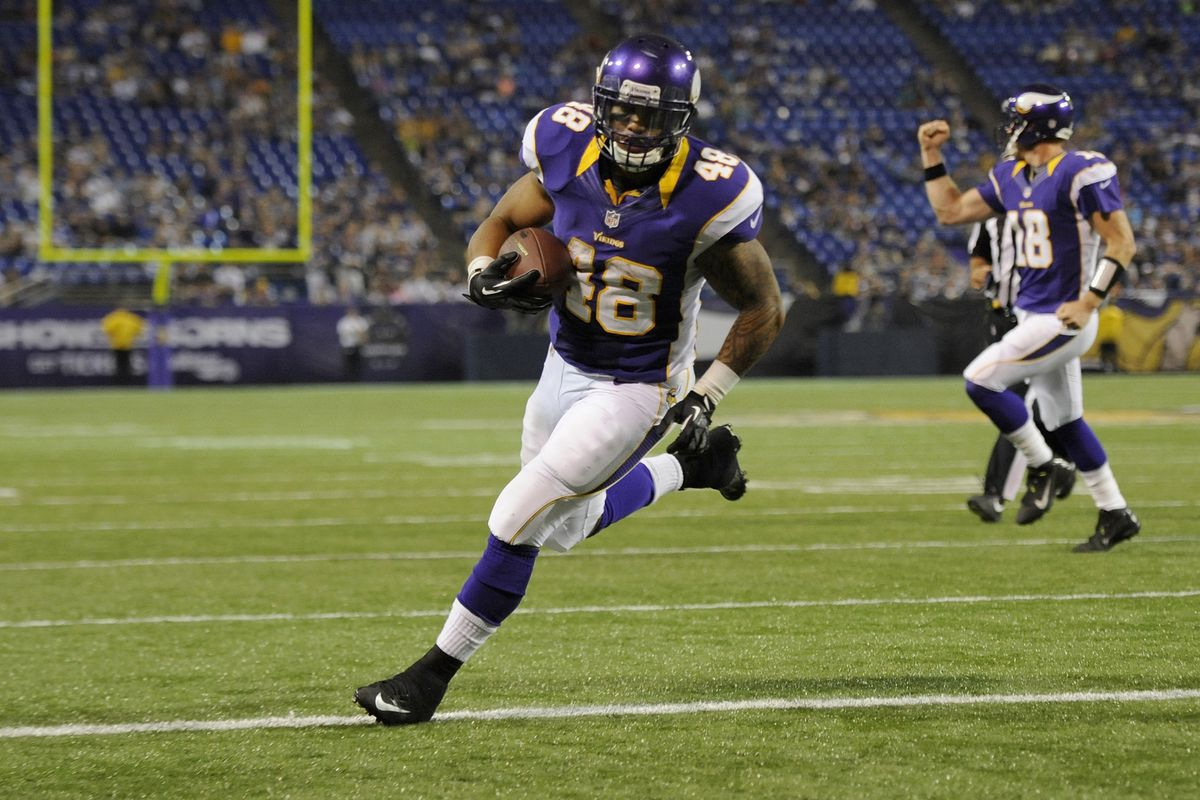 Matt Asiata is battling for the third running back spot for the Vikings. Is he the favorite at this point? (Photo by Hannah Foslien/Getty Images)