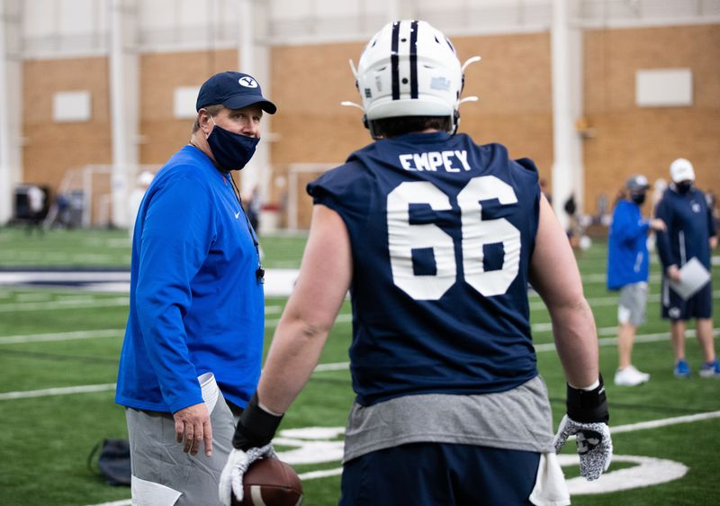BYU offensive line coach Darrell Funk coaches at BYU's indoor practice facility during 2021 spring camp in Provo, Utah.
