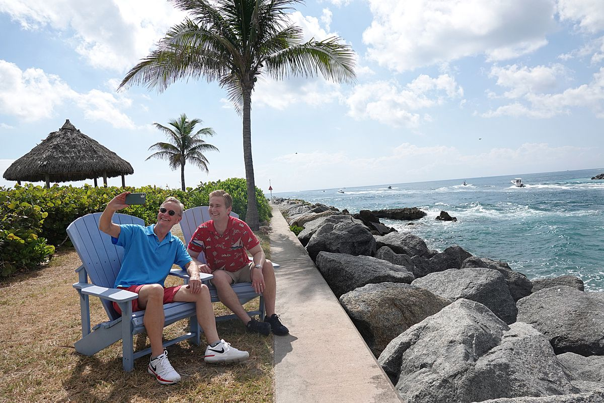 Steve Doocy, left, and his son, Peter Doocy, both of Fox News, enjoy the Florida coast on a recent family vacation.