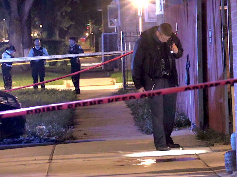 Police investigate a shooting about 2:30 a.m. Sunday, October 14, 2018 in the 1100 block of North Long Avenue in Chicago.   Justin Jackson/ Sun-Times
