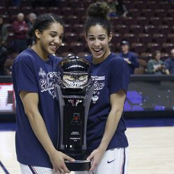 UConn seniors Gabby Williams (L) and Kia Nurse (R) pose with the 2018 AAC Championship Trophy.