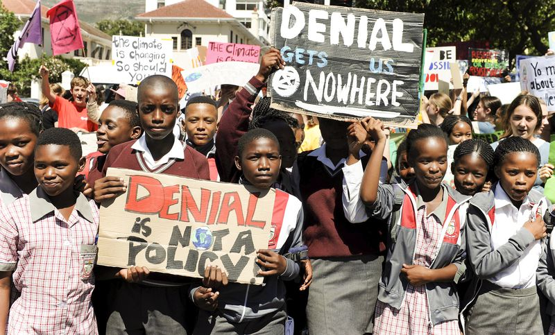 Students in Cape Town, South Africa take part in a protest, Friday, March 15, 2019 as part of a global student strike against government inaction on climate change.