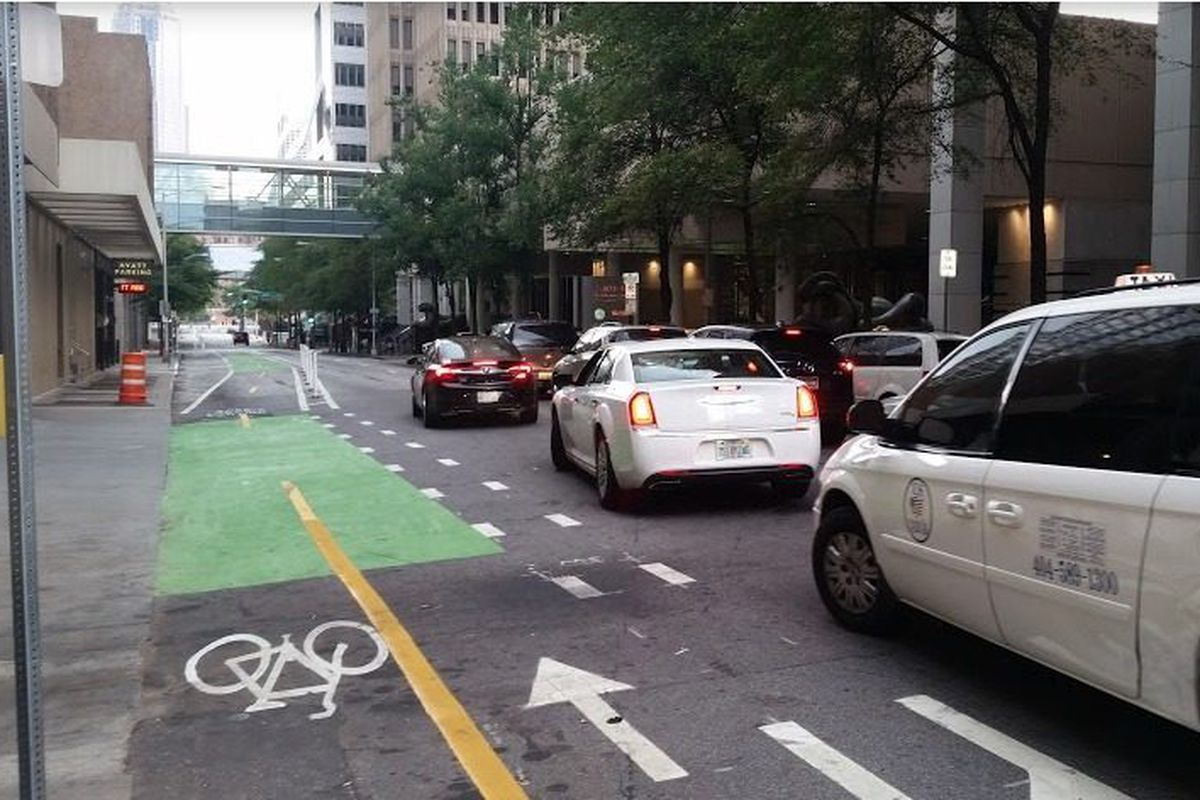 [Opening weekend for downtown's cycle track. All photos: Curbed]