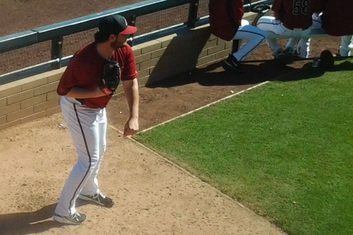 Holmberg warms up in the bullpen before coming in vs. the Cubs.