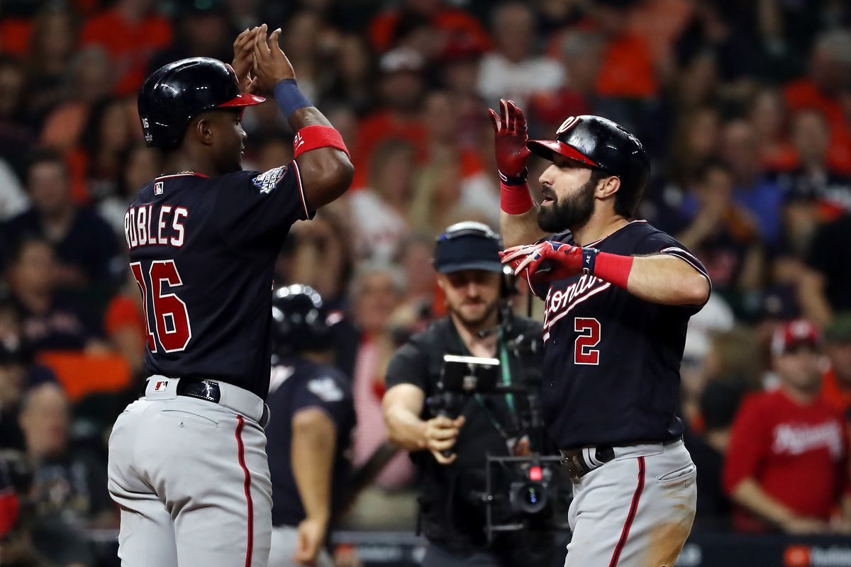 Washington Nationals outfielder Adam Eaton is congratulated by his teammate Victor Robles after hitting a two-run home run against the Houston Astros in Game Two of the 2019 World Series at Minute Maid Park on October 23, 2019 in Houston, Texas.