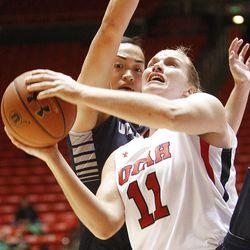 Utah's Taryn Wicijowski, right, slips past Utah State's Franny Vaaulu for a shot under the basket as Utah and Utah State play Nov. 27, 2012, in the Huntsman Center. Utah won 92-64.