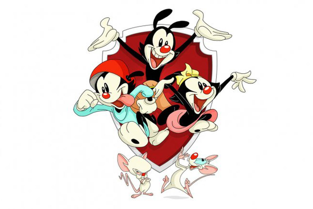 Yakko, Wakko, and Dot burst from leap from a Warner Bros. shield and over the heads of Pinky and the Brain in promotional art for Animaniacs reboot.