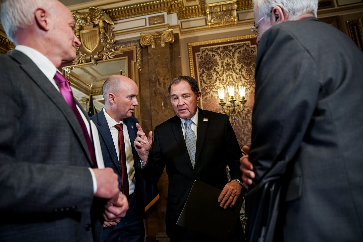 Dr. Kurt Hegmann, director of the Rocky Mountain Center for Occupational and Environmental Health, Lt. Gov. Spencer Cox, Gov. Gary Herbert, and Dr. Joseph Miner, executive director of the Utah Department of Health, confer after a press conference at the Capitol in Salt Lake City on Friday, March 13, 2020. Officials announced at the press conference that Utah's K-12 schools will experience 'soft closure' for 2 weeks as the state deals with the spread of COVID-19.