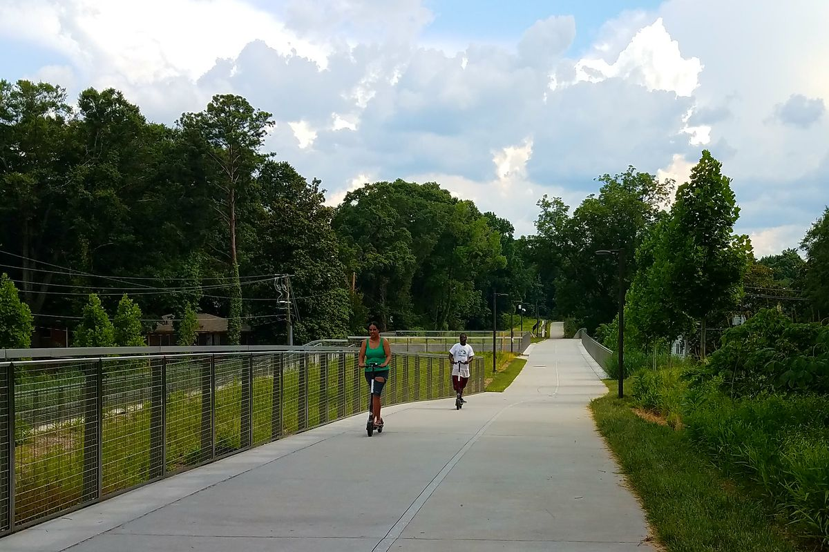 Bird patrons enjoy a leisurely, motorized scoot on the Beltline's Westside Trail recently.