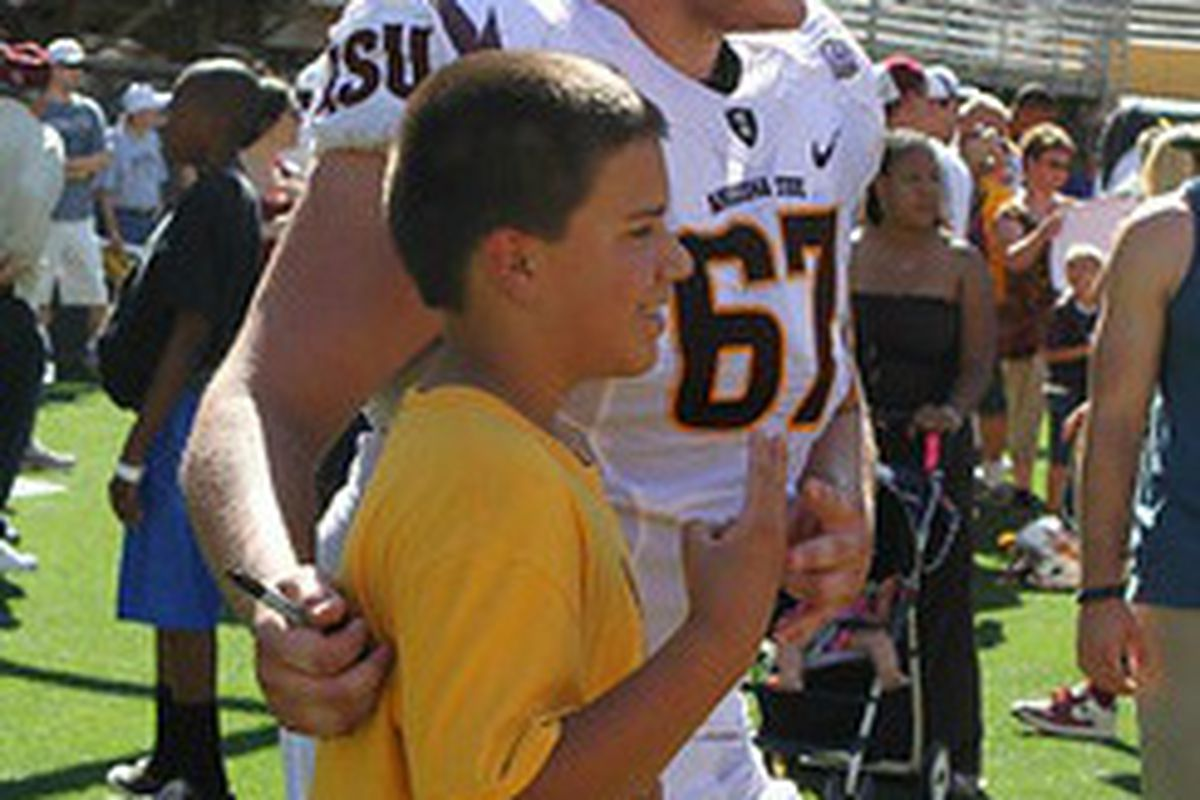 Kody Koebensky takes a photo with a young fan after April's Spring Game (Photo: ASU)