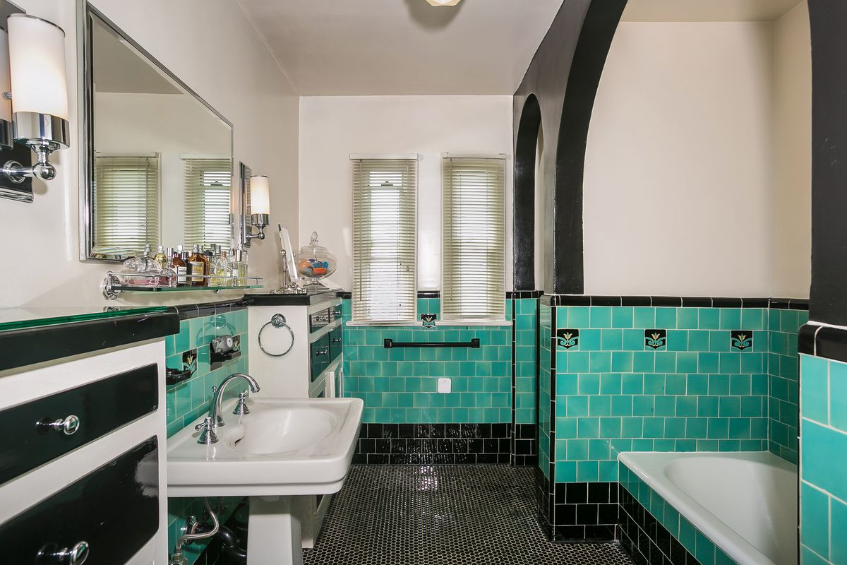 Then There S The Lower Level Bathroom Which Sports A Very Lovely Blue Green And Black Tile Design With Arching Shapes Original Built In Cabinetry