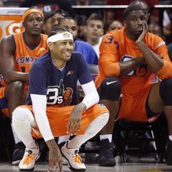 3's Company player/captain and coach Allen Iverson, center, kneels on the sideline during the first half of Game 3 in the BIG3 Basketball League debut, Sunday, June 25, 2017, at the Barclays Center in New York.