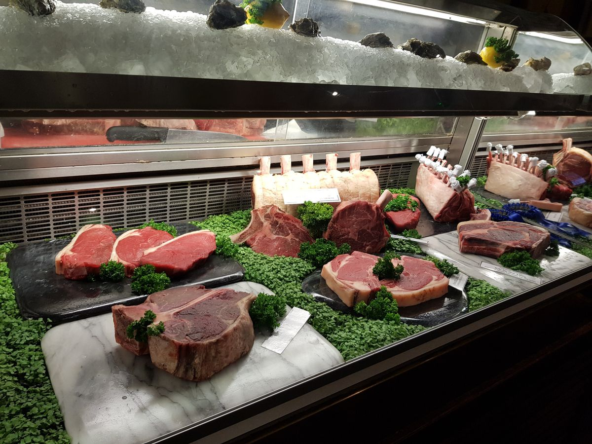The beef counter, with rib eyes, chops, and sirloin steaks at the Guinea Grill, one of London's best steak restaurants