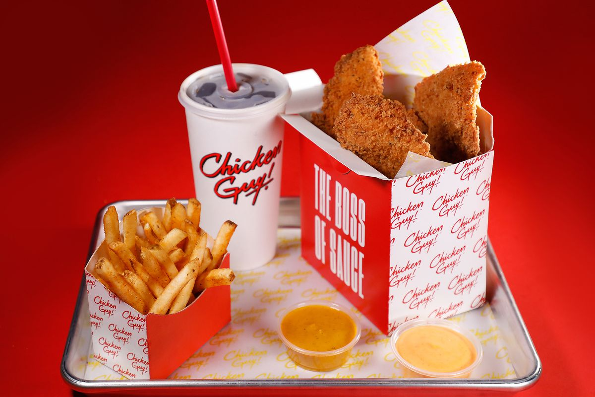 Fries, a soda, chicken fingers, and dipping sauce from chicken guy