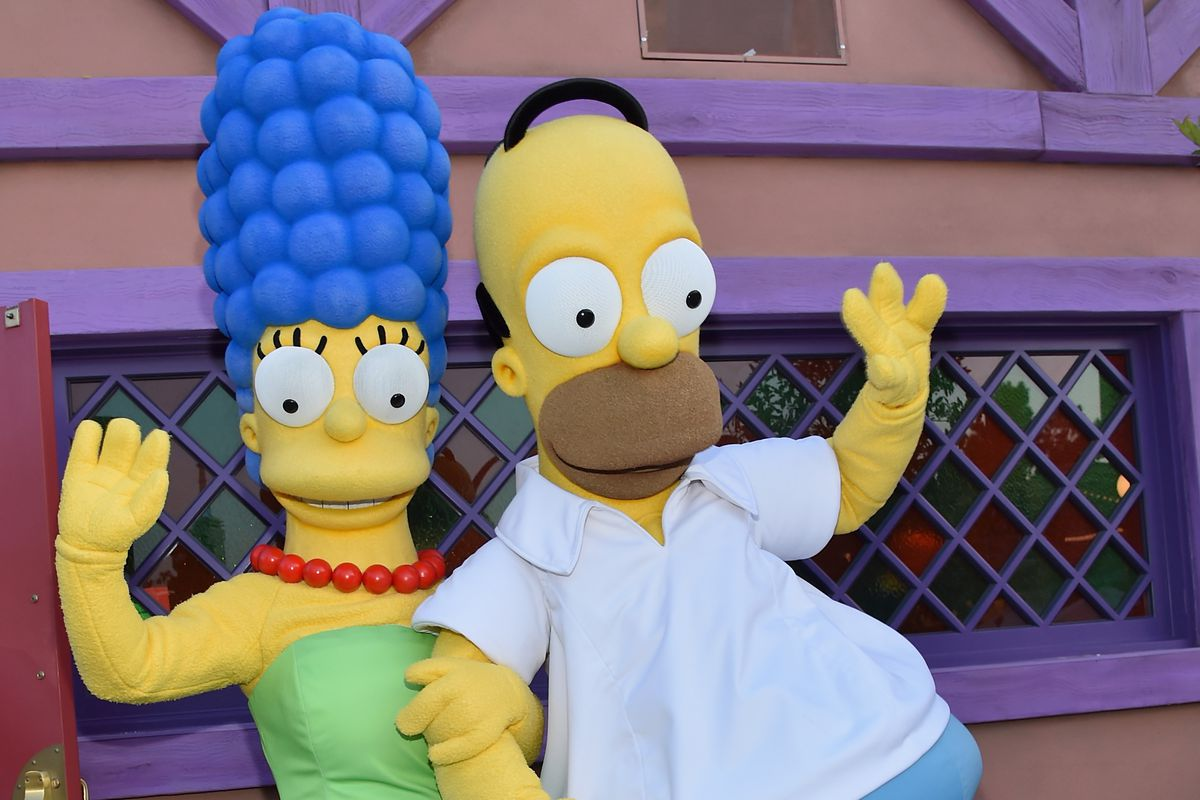 UNIVERSAL CITY, CA - MAY 12:  Marge Simpson and Homer Simpson attend the 'Taste of Springfield' press event at Universal Studios Hollywood on May 12, 2015 in Universal City, California.  (Photo by Alberto E. Rodriguez/Getty Images)