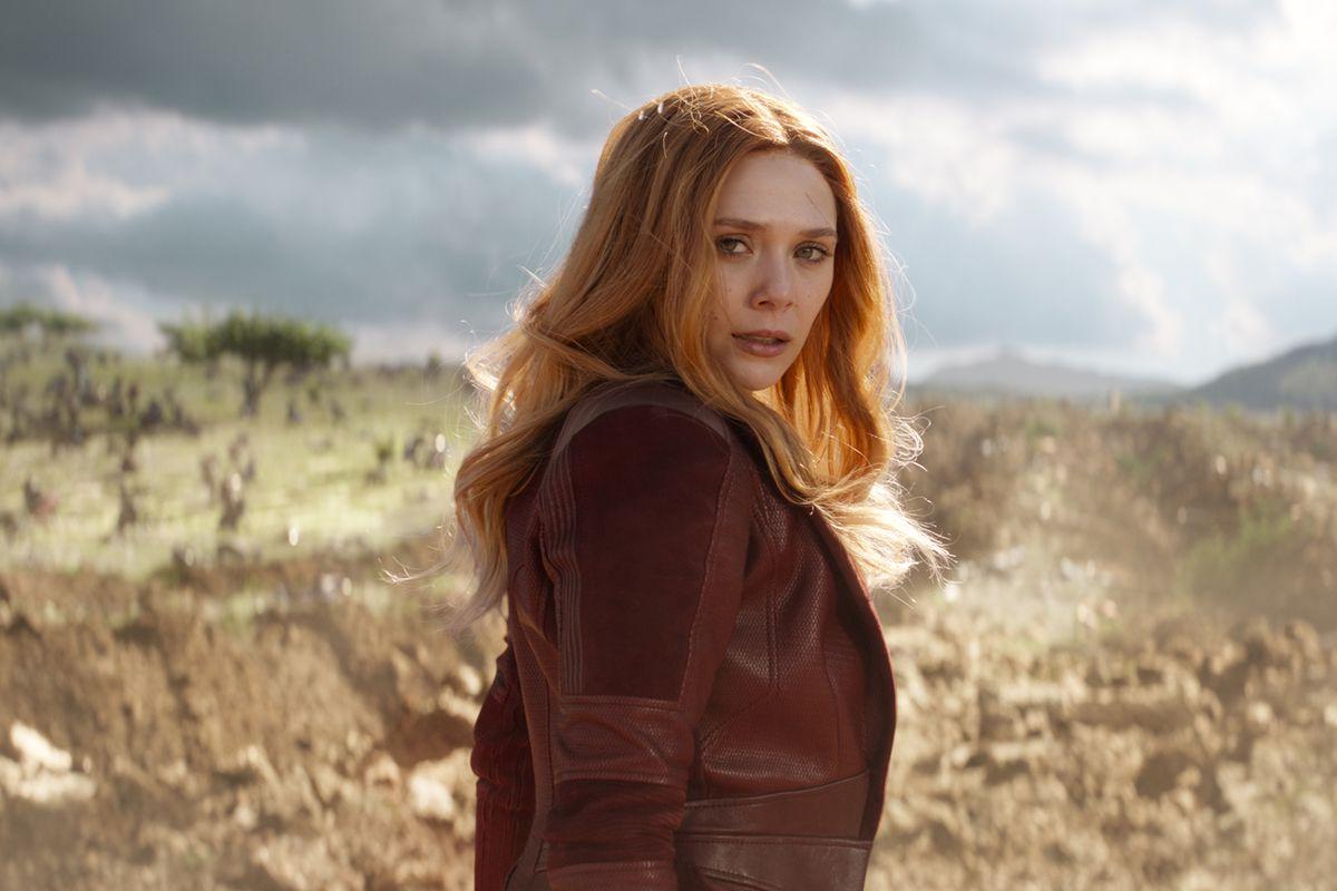 Scarlet Witch/Wanda Maximoff (Elizabeth Olsen) looks over her shoulder on a Wakandan battlefield in Avengers: Infinity War.