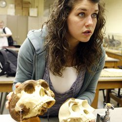 Teaching assistant Katie Fager uses model skulls to teach evolution at BYU in Provo on Friday, March 30, 2012.