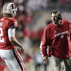 Wisconsin coach Bret Bielema talks to quarterback Joel Stave (2) during the second half of an NCAA college football game against Utah State on Saturday, Sept. 15, 2012, in Madison, Wis. Wisconsin won 16-14.