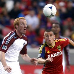 Luis Gil (right) of Real Salt Lake battles for control of the ball against Jeff Larentowicz of the Colorado Rapids during their MLS match up at Rio Tinto Stadium in Sandy Saturday, April 7, 2012.