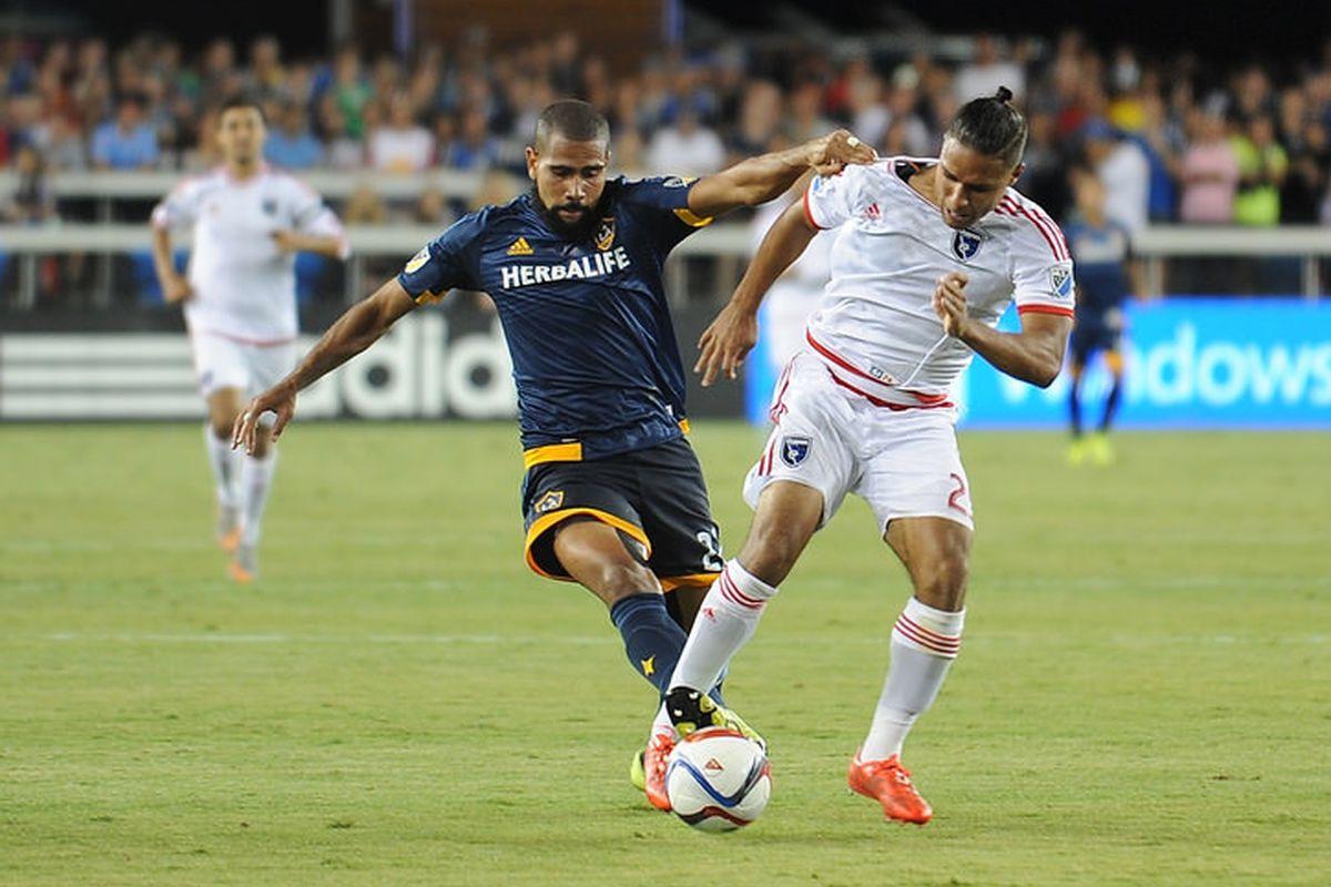 Leonardo pulls down Qunicy Amarikwa, denying a clear goal scoring opportunity