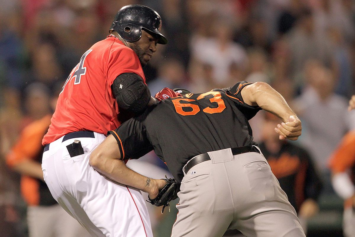 BOSTON, MA - JULY 8:  David Ortiz #34 of the Boston Red Sox and pitcher Kevin Gregg #63 of the Baltimore Orioles fight in the bottom of the eighth inning at Fenway Park on July 8, 2011 in Boston, Massachusetts.  (Photo by Jim Rogash/Getty Images)